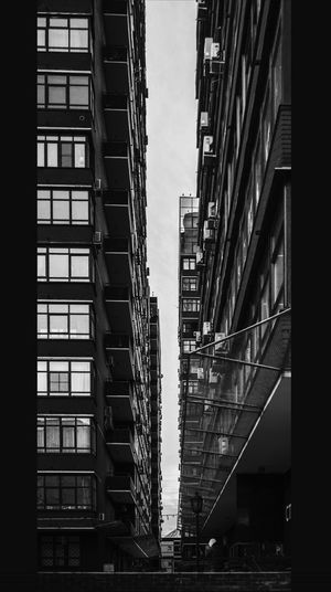 Man in sky walking Black & White Lines SlenderMan The Graphic City Architecture Bigfoot Blackandwhite Blackandwhite Photography Building Exterior Built Structure City Day Fire Escape Lines And Shapes Low Angle View Modern No People Outdoors Skyscraper Tall Thin Tilt Shift Tiltshift Walking