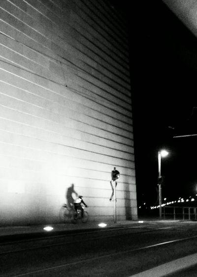 Blurred motion of man walking on road at night