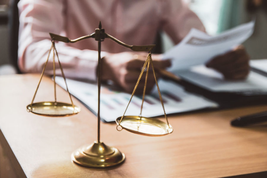 Scale Law. businessman working reading contract at office. Business Man People Scale  Justice - Concept Courtroom Gavel Legal System Table Representing Close-up Lawyer Evidence Brass Fingerprint Prison Legal Trial Courthouse