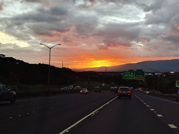 as the sun sets on my first day back in honolulu Dramatic Sky Orange Color Sunset_collection Sunset Highways&Freeways On The Road In A Car Eyeemphotography EyeEm Gallery Mobile Photography Playing Tourist My Hometown Road Sunset Silhouettes Mountains And Sky Dusk