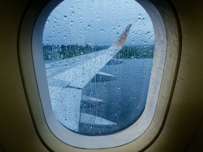 Close-up of wet airplane window