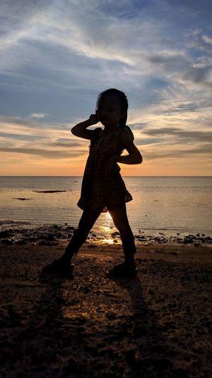 Full length of child on beach during sunset