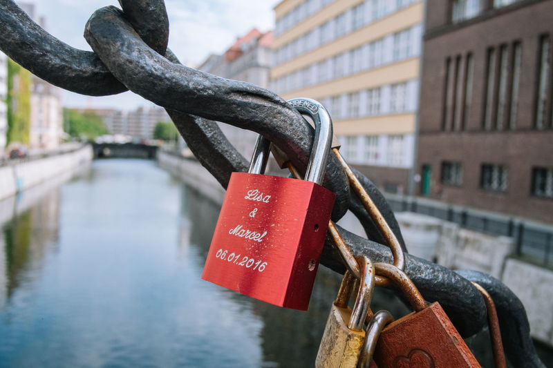 Berlin Berlin Bridge - Man Made Structure Built Structure Close-up Day Focus On Foreground Hanging Hope Hope - Concept Lock Love Love Lock Luck Metal No People Outdoors Padlock Red River Safety Security Water