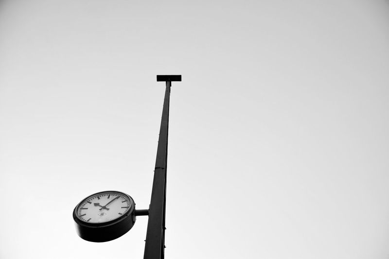 Low Angle View Of Clock On Pole Against Clear Sky At Dortmund Hauptbahnhof