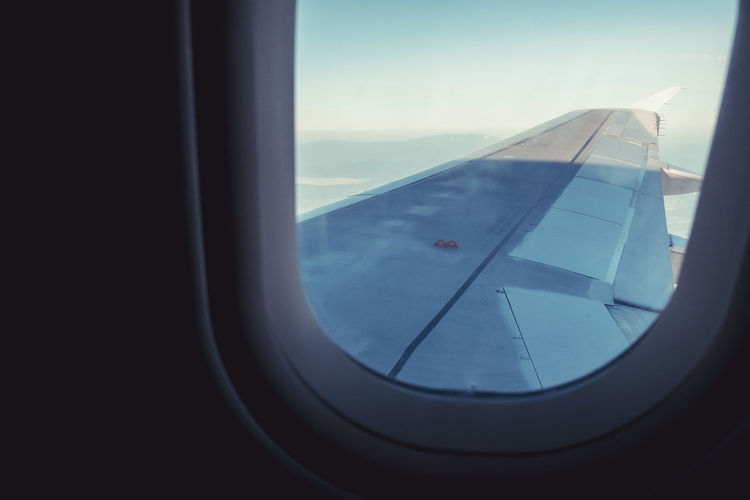 Close-up of airplane wing seen through window