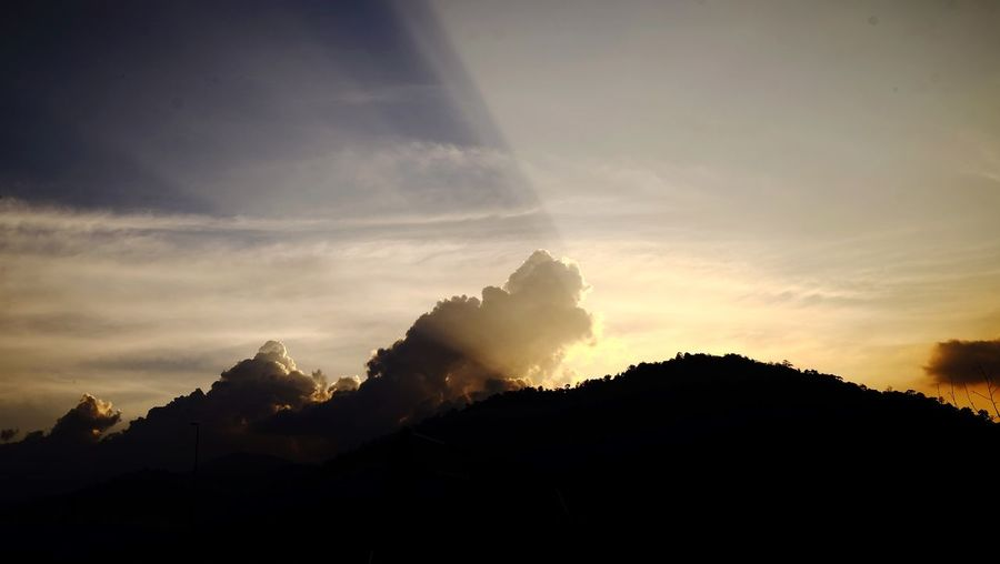 Sunset light throgh the mountain and cloud Silhouette Nature Sunset Sky Beauty In Nature No People EyeEmNewHere Scenics Outdoors Mountain Landscape Day