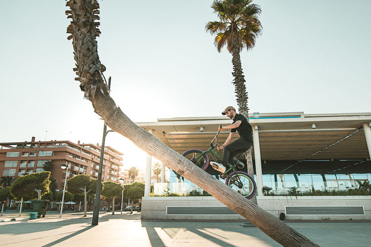 Man on bicycle against clear sky