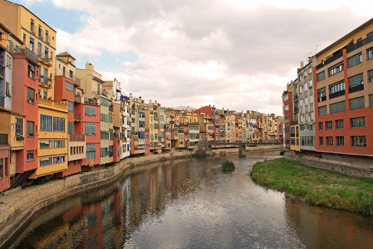 Just wandering in Girona Architecture Building Building Exterior Built Structure Canal City City Life Cloud - Sky Cloudy Day Girona Nature No People Outdoors Overcast Residential Building Residential District Residential Structure Rippled River Sky Town Travel Destinations Water Waterfront