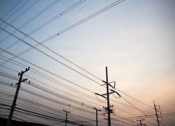 Silhouetted sunset power line Cross Grid Industrial Lines Post Silhouette Transmission Backgrounds Cable Connection Electricity  Energy Low Angle View Network No People Outdoors Parallel Power Line  Power Supply Sky Technology Telephone Line Voltage Wire