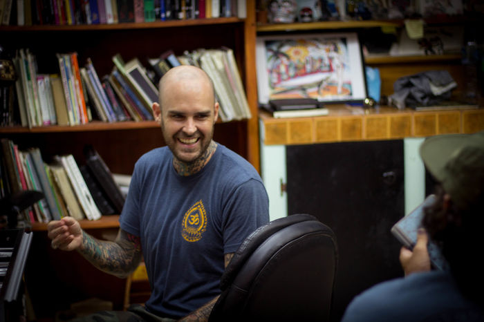May I introduce @jasontylergrace He is an American tatto artist and avid ex(?!) traveler who has now settled down in Santa Teresa with his goddess Italian wife @giulia_vallotto_grace. The first in meeting Jason was Etienne when training jiujitsu here. It never seizes to amaze me how particularly this sport brings people together. Then, one day, we met for lunch, one gin led to the next rum, lunch became dinner, and at the end of it, Etienne had a new tattoo... Definitely one of my favorite days in Santa Teresa. Jason is an inspiration for us, he traveled for 2 years, then worked in New York for a while and decided to leave the Big Apple to write his own story in Central America. I am grateful for the people I've been meeting on this journey and the beautiful places they take me to with their life stories... Bald Man Casual Clothing Central America Costa Rica Indoors  Laughing Lifestyles Man Person Shaven Hair Tattoo Tattoo Artist Tattoo Shop Travel Photography Young Adult