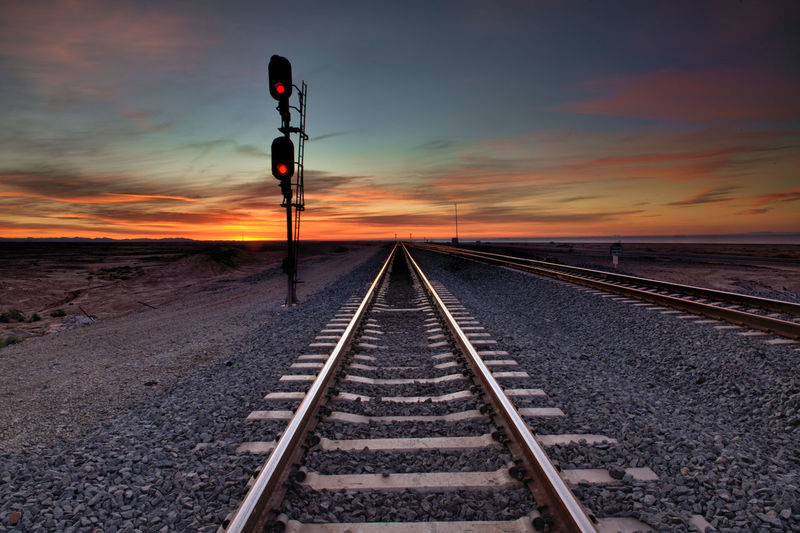Track Rail Transportation Railroad Track Transportation Sky Cloud - Sky Sunset Direction Nature The Way Forward Diminishing Perspective Signal No People Railway Signal Sign vanishing point Scenics - Nature Beauty In Nature Outdoors Tranquil Scene Light Straight