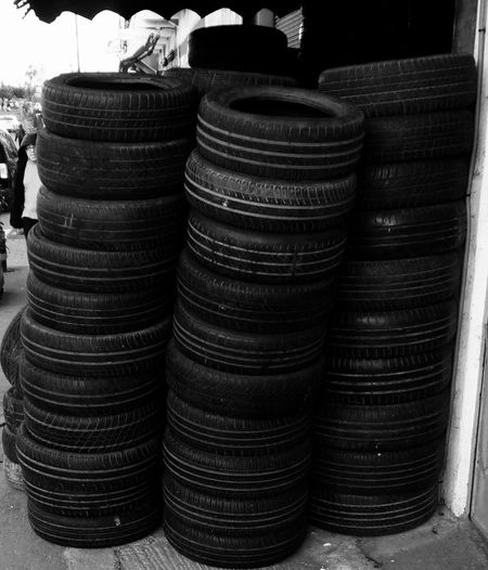 Here is to a fucking Good-Year 😂😂😂 Blackandwhite Black Vs White Shades Of Grey Stack Tires Stacking Streetphotography Outside Small Business On The Road Mobilephotography Shootermag AMPt_community Vscocam VSCO Snapshots Of Life Snapseed AndroidPhotography Casual Visual Witness Mnmlsm Minimalist Minimalarchy Minimalistic Goodyear