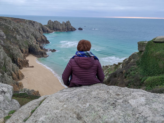just love the south Look The Other Way Just Smile  Eyeemlandscape Woman Looking Out To The Sea And Logan Rock Cornwall Logan Rock Britain Horizon Over Water Landscape Photography Cornish Coastline Water Wave Sea Beach Women Sand Back Rear View Sky Headland Rocky Coastline Ocean Calm Coastline Seascape Rugged Stack Rock Looking At View Rock Formation Escapism Exploring Fun The Traveler - 2019 EyeEm Awards The Great Outdoors - 2019 EyeEm Awards