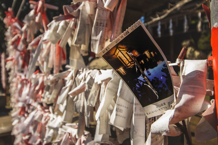 EyeEmNewHere Japan Tickets Backgrounds Bokeh Communication Cultures Day Focus On Foreground Full Frame Hanging Large Group Of Objects No People Object Outdoors Paper Religion Selective Focus Shrine Spirituality Text