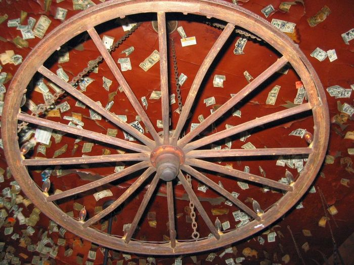 Pay Up Fun, Unique, Different Wooden Wagon Wheel Money From Around The World 1800's Saloon Old But Awesome Old Western Saloon Western Old, Weathered Ceiling 1800's Building Money Covered Ceiling Old West  Old And Weathered Antique Wooden Wagon Wheel Close Up Photography Western USA 1800´s And Today Old West Bar EyeEmBestPics EyeEm Gallery EyeEm Best Shots Old West Still Alive Full Frame Indoors  Old, Western, Rustic