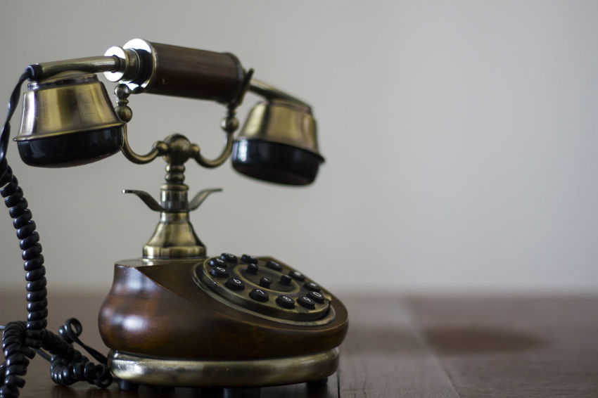 Vintage phone on wooden table Antiquated Antique Classic Copy Space Retro Call Communication Connection Dial Handset Landline Phone Nostalgia Number Old Old Telephone Phone Retro Style Retro Styled Style Talk Telecommunications Equipment Telephone Vintage Vintage Phone Wood - Material
