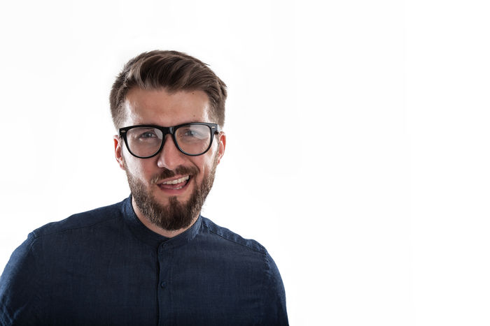 Portrait of handsome young bearded nerd with glasses on a white background. Copy Space Isolated Nerd Place Beard Businessman Cheerful Close-up Day Eyeglasses  Happiness Headshot Indoors  Looking At Camera Manager Masculine Mid Adult Model One Person People Portrait Smiling Studio Shot White Background Young Adult