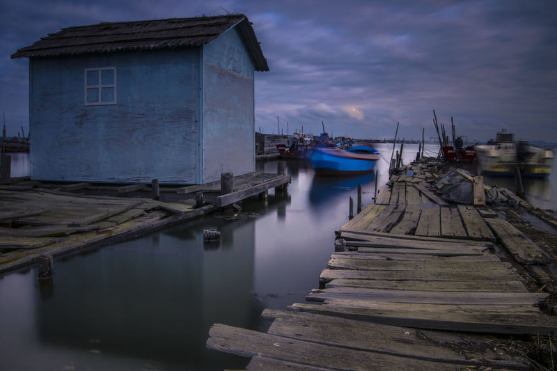Architecture Building Building Exterior Built Structure Cloud - Sky Dusk Mode Of Transportation Moored Nature Nautical Vessel No People Outdoors Pier Port Reflection Sea Sky Transportation Water Wood - Material Wooden Post