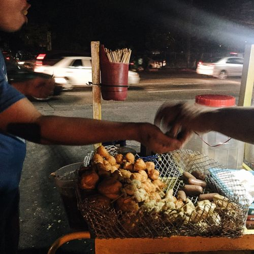 Fried Squid, quail egg, chicken intestine, tofu, and sausage are sold on a sidewalk for 3php a piece in Quezon City, Philippines. Street Food Food EyeemPhilippines Quezon City Philippines