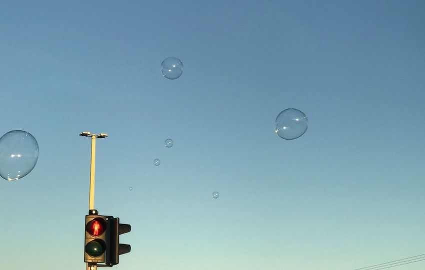 Bubbles down the roca Traffic Lights Giant Bubbles Bubbles Low Angle View No People Clear Sky Sky Illuminated Outdoors Close-up Day Go Higher
