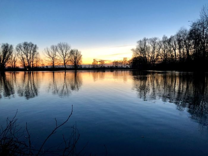 Nikon EyeEm Nature Lover Enjoying Life Calm Tranquil Scene Tranquility Reflection Water Tranquil Scene Beauty In Nature Nature Tree Sunset Silhouette Tranquility Lake Scenics Idyllic Outdoors Sky No People Bare Tree Day