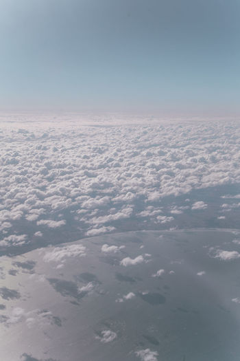 en route to Iceland View From Above Plane View Clouds Sea Pastel Landscape Environment Planet Earth Space Flying Water Blue Aerial View Airplane Plane Stratosphere Sky Only Cumulonimbus Fluffy Cloudscape