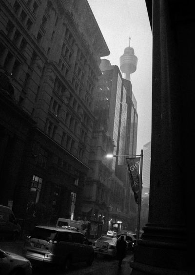 Dark city Rainy Days Street Photography Streetphotography Street Architecture Building Exterior Built Structure City Street Car Land Vehicle Outdoors Skyscraper Road Day Modern Transportation Sky No People