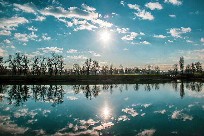 Sky Reflection Cloud - Sky Water Sun Nature Sunlight Waterfront No People Sunbeam Tree Lake Beauty In Nature Tranquility Outdoors Day Lens Flare Nature_collection Naturelovers Eye4photography  Eye4nature EyeEmNewHere EyeEm Best Shots The Week on EyeEm Bestoftheday