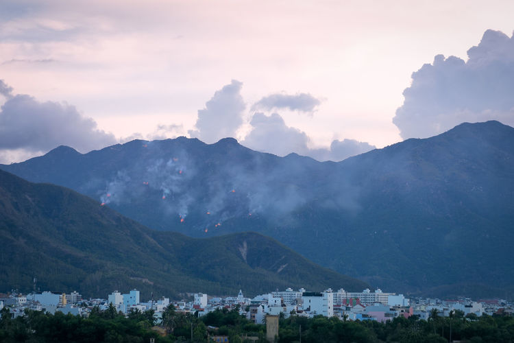 An evening view of the fire across the forest hills just outside the town. nha trang, vietnam
