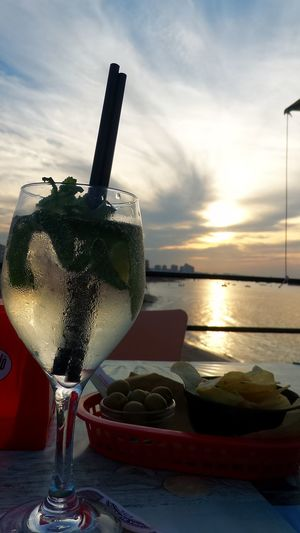 Sunset and Martini Royal! Drink Drinking Glass Cocktail Drinking Straw Table Food And Drink Alcohol No People Refreshment Beach Sunset Close-up FoodOutdoors Water Freshness Sea Healthy Eating