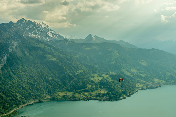High angle view of person on mountains against sky