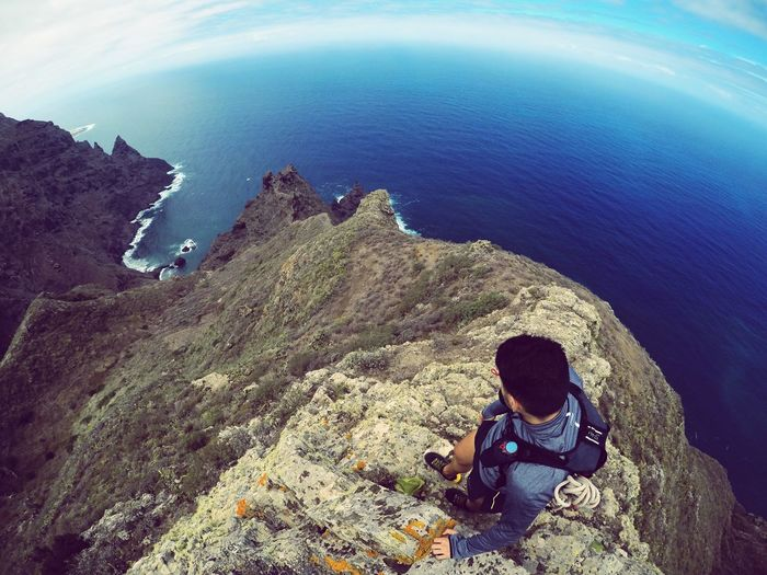 Lost In The Landscape Sitting One Person High Angle View Real People Sea Day Nature Water Outdoors Wireless Technology Beauty In Nature Sky People