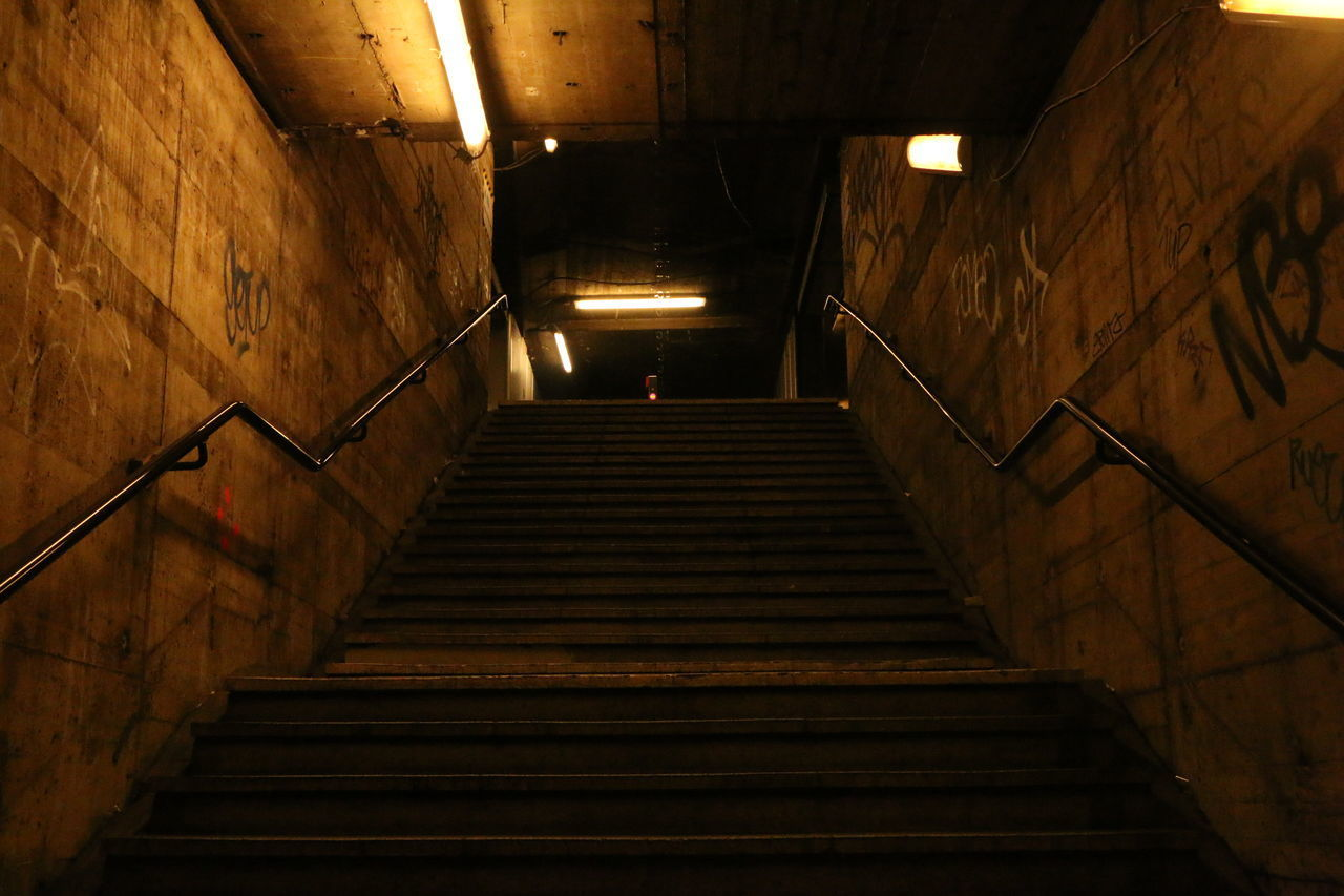 LOW ANGLE VIEW OF STEPS IN TUNNEL