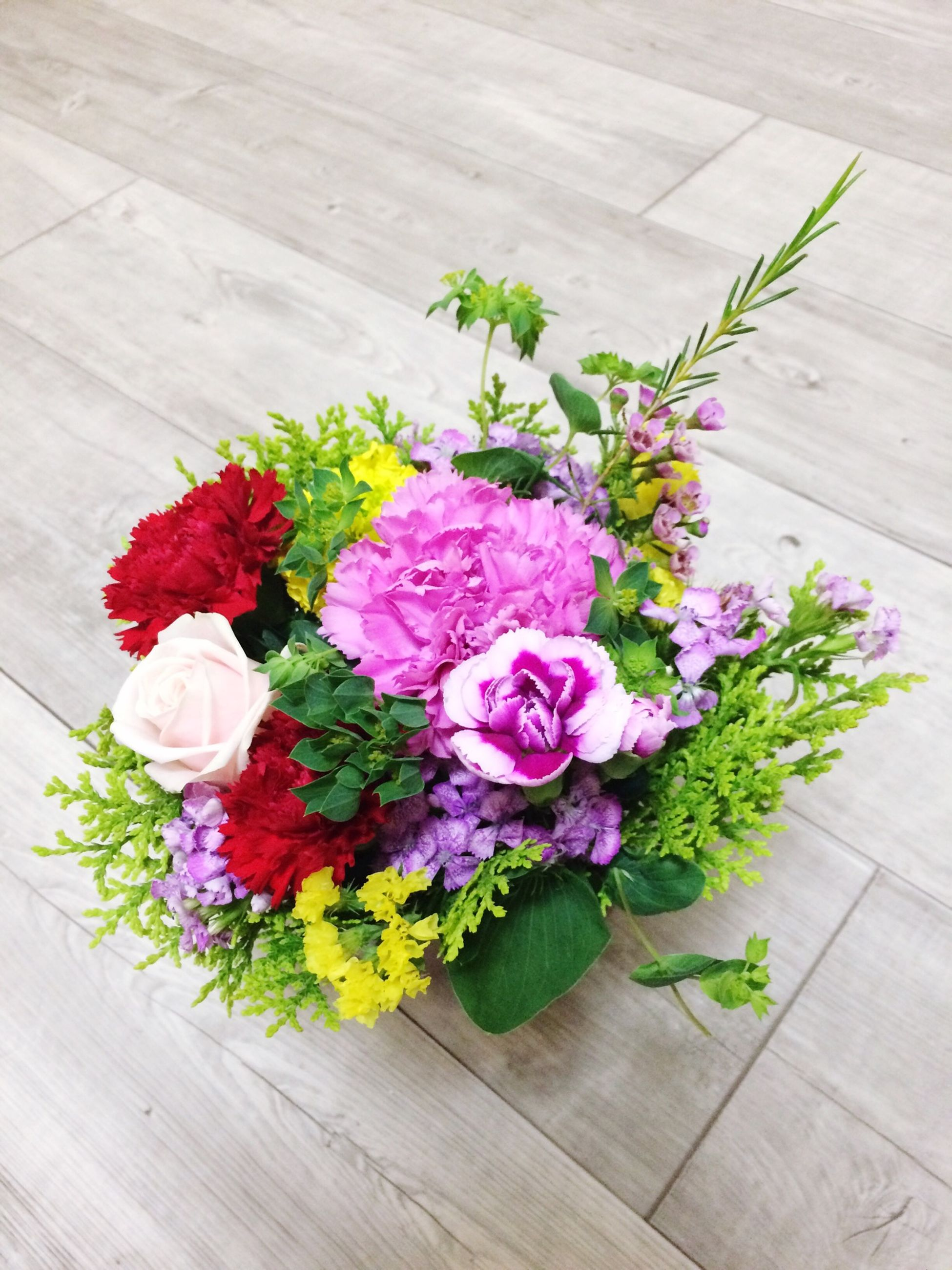 flower, freshness, petal, fragility, high angle view, flower head, indoors, table, wood - material, beauty in nature, plant, growth, bouquet, leaf, nature, vase, bunch of flowers, potted plant, wooden, flower arrangement