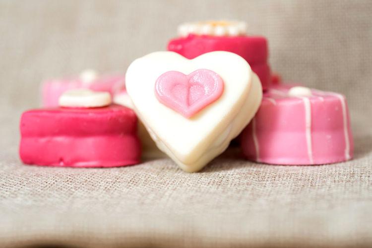 Close-up of heart shape desserts on sack