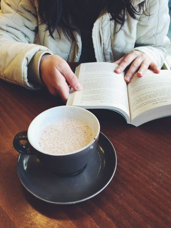 Girl reading a book in a cafe. Cup of coffee and book Women Coffee Reading Table Studying Library Book Cafe Cup Girl