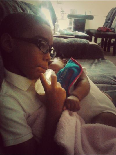 to cute my nephew wanted to put JOURNEE to sleep while watching TV