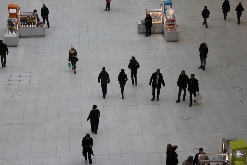 Tourists walking around Oculus plaza Interior Oculus NY Group Of People Large Group Of People Real People Crowd Walking High Angle View City Architecture Men Women Adult Travel City Life Winter Transportation Day Warm Clothing