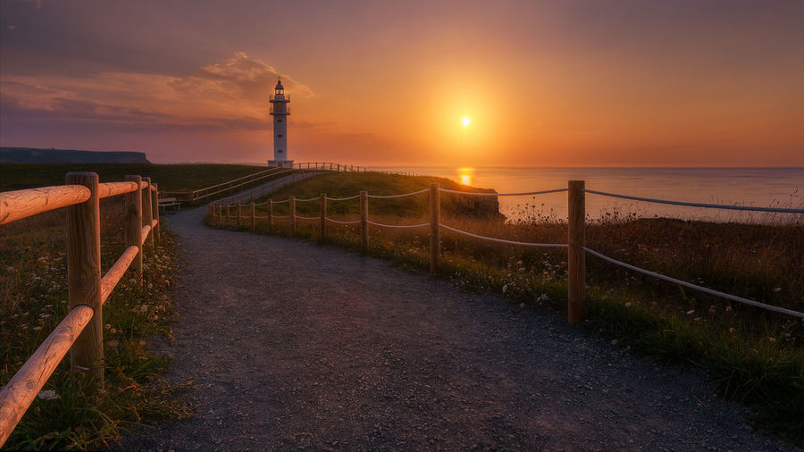 Lighouse in the north of spain Lighthouse Lighthouse Lovers Lighthousephotography Landscape Colour Low Angle View Spain, Andalucia, Malaga Cantabria Faro De Ajo. Wood Composition Light Sun Summer Sunset Sunrise Travel Europe Outdoors