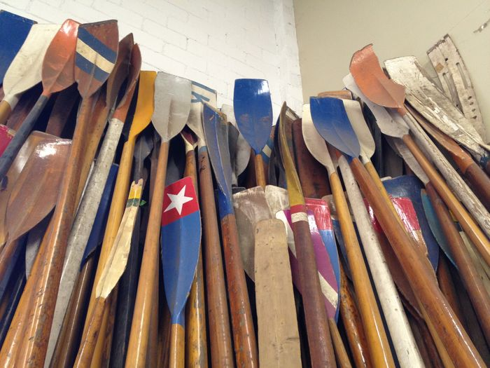 Low Angle View Of Wooden Oars Leaning On Wall