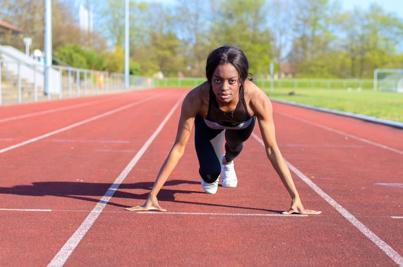 Portrait of female athlete on running track