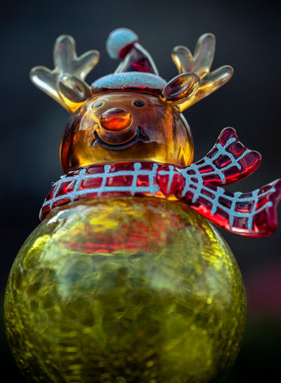Reindeer Christmas ornament wearing a scarf and hat. Celebration Christmas Event Gold Hanging Holiday Ornament Pine Raindeer Red Rudolph Tradition Tree Winter Xmas Bauble Close-up Decoration Festive Glass Indoors  No People Scarf Seasonal Toy Holiday Moments