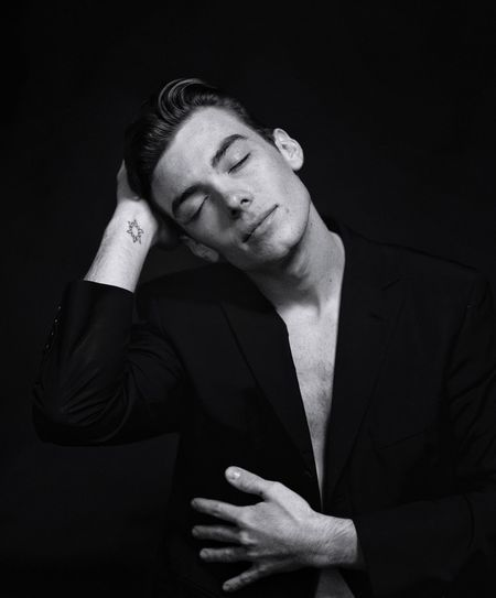 Dreaming Young Man One Person Studio Shot Real People Young Adult Front View Lifestyles Black Background Suit Indoors  Human Hand Well-dressed