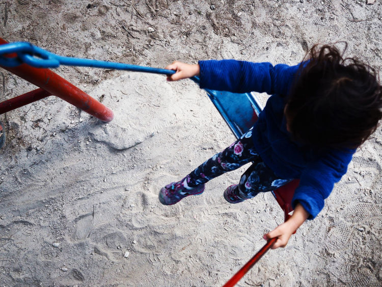 Swinging girl Blue Color Childhood Childhood Memories Day Family From Where I Stand Fun Girl Leisure Activity Lifestyles One Person Outdoors Play Playground Real People Sand Swing Travel Birdeyeview Uniqueness