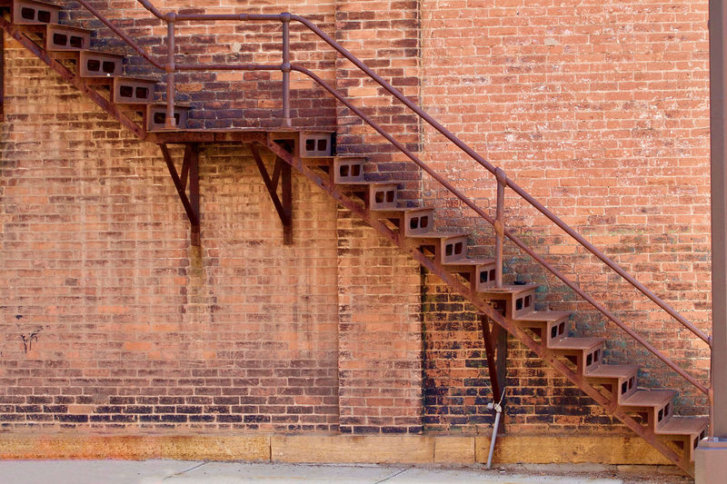 Steps against red brick wall