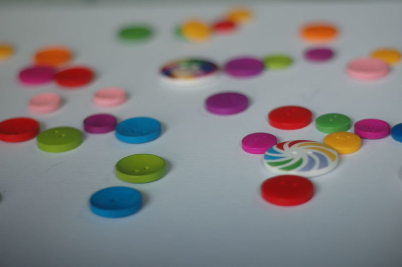 Close-up of colorful buttons on table