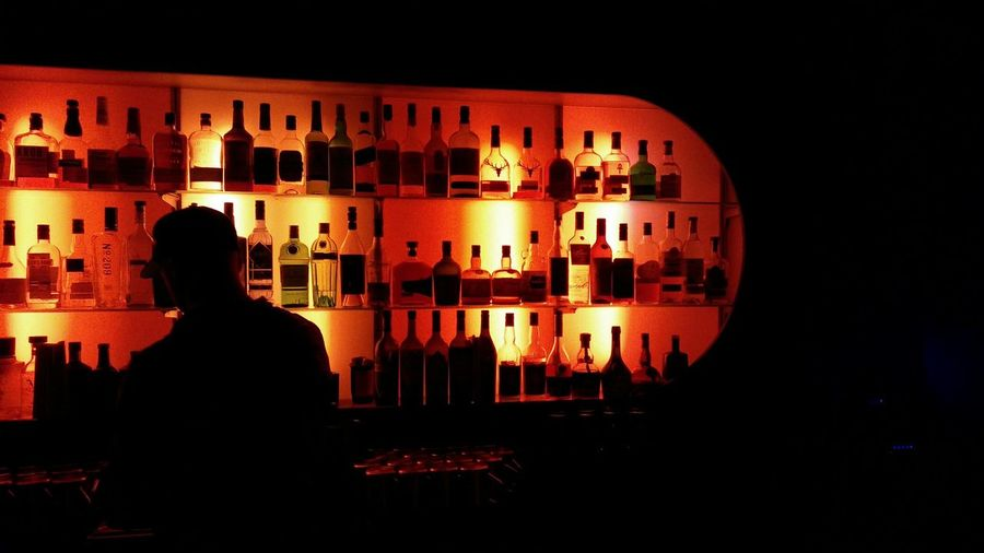 A Bar. · Hamburg Germany 040 Hh Drinks Barkeeper Bottles Shelves Well-stocked Silhouette Light And Shadow Lighting Contours