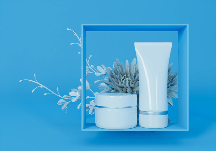 Close-up of potted plant on table against blue background
