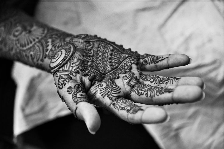 High Angle View Of Henna Tattoo On Hand