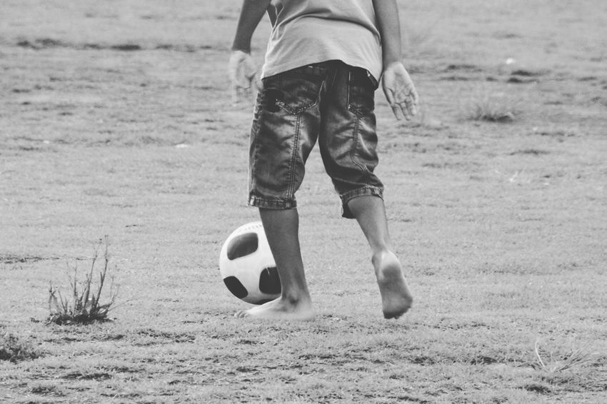 Soccer Ball One Person Low Section Child Soccer Ball One Boy Only People Outdoors Day Boy Kid The Street Photographer - 2017 EyeEm Awards Fun Running Park Blackandwhite Black And White Black & White Blackandwhite Photography Black And White Photography Black&white EyeEm Best Shots Eye4photography  EyeEm Gallery This Is Latin America Focus On The Story World Cup 2018
